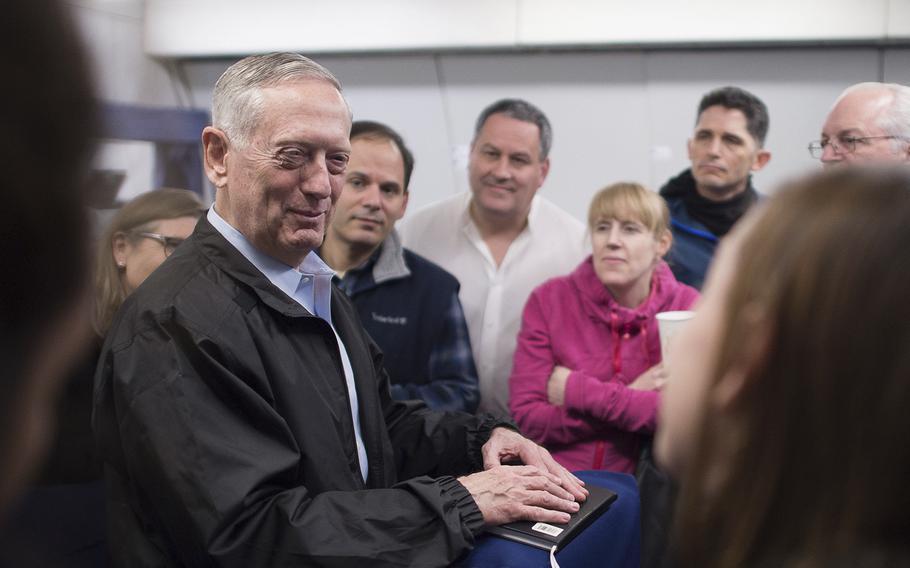 Secretary of Defense Jim Mattis answers questions during a flight to Korea. on Feb. 1, 2017.