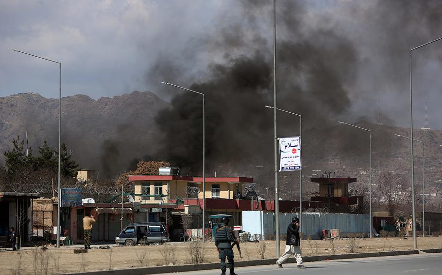 Smoke rises from a district police headquarters after a suicide bombing in Kabul, Afghanistan, Wednesday, March 1, 2017.