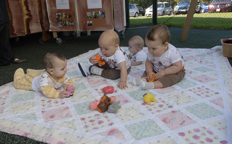 Babies spend time outdoors on a warm fall day at the Air Force's Vogelweh Child Development Center in Kaiserslautern, Germany. Officials say staffing shortages due to the federal hiring freeze may affect some families seeking on-base child care in the Kaiserslautern Military Community.