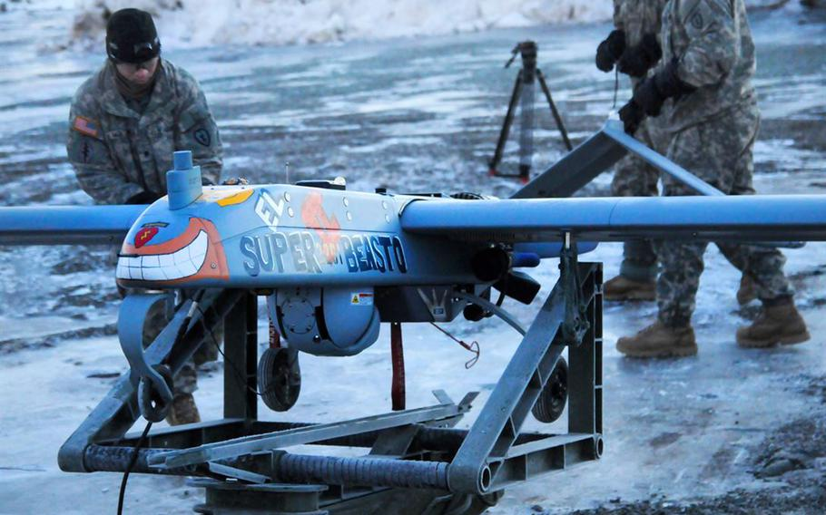 Paratroopers prepare an RQ7 Shadow unmanned aircraft system for launch on Forward Operating Base Sparta on Joint Base Elmendorf-Richardson, Alaska, Jan. 30, 2014. A Shadow RQ-7Bv2 unmanned aircraft went missing for 10 days after it was launched from southern Arizona on Jan. 31.