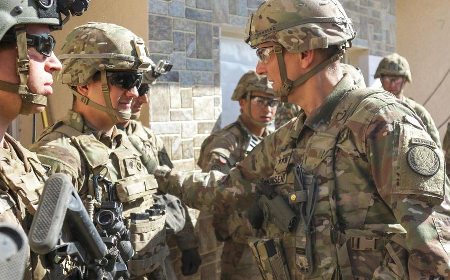 Lt. Gen. Stephen Townsend, right, meets with U.S. troops at tactical assembly area Hamam al-Alil, Iraq, on Feb. 22, 2017.