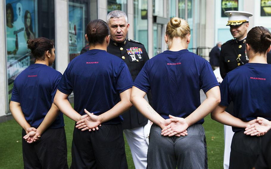 Female U.S. Marine Corps enlistees meet Maj. Gen. Paul Kennedy, commanding general of Marine Corps Recruiting Command, outside of the Fox News building in New York City, Aug. 17, 2016.