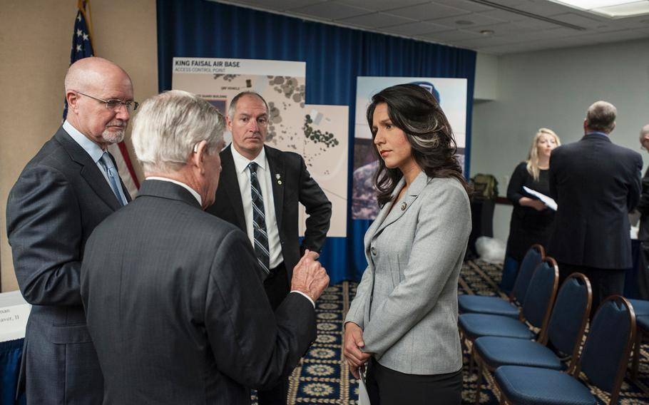Congresswoman Tulsi Gabbard, D-Hawaii, attends a National Press Club event in Washington, D.C., on  Tuesday, March 7, 2017, as the fathers of three Green Berets killed in Jordan on Nov. 4, 2016, give details of how their sons were killed. Clockwise from Gabbard's left are, James Moriarty, Sr., father of Staff Sgt. James Moriarty; Brian McEnroe, father of Staff Sgt. Kevin McEnroe; and Chuck Lewellen, father of Sgt. 1st Class Matthew Lewellen.