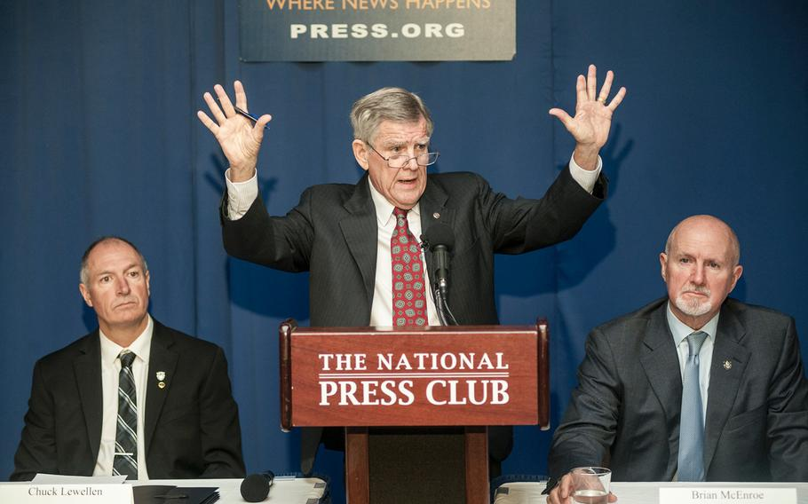 James Moriarty, Sr., holds up his hands during a National Press Club event in Washington, D.C., on Tuesday, March 7, 2017, as he demonstrated how his son, Staff Sgt. James Morarity called for help as a Jordanian military officer fired upon him and two other Green Berets who died in the Nov. 4, 2016, incident in Jordan.