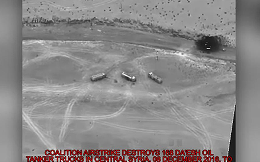 A file photo shows the aftermath of a coalition airstrike against Islamic State oil tankers near Palmyra, Syria, Dec. 8, 2016.
