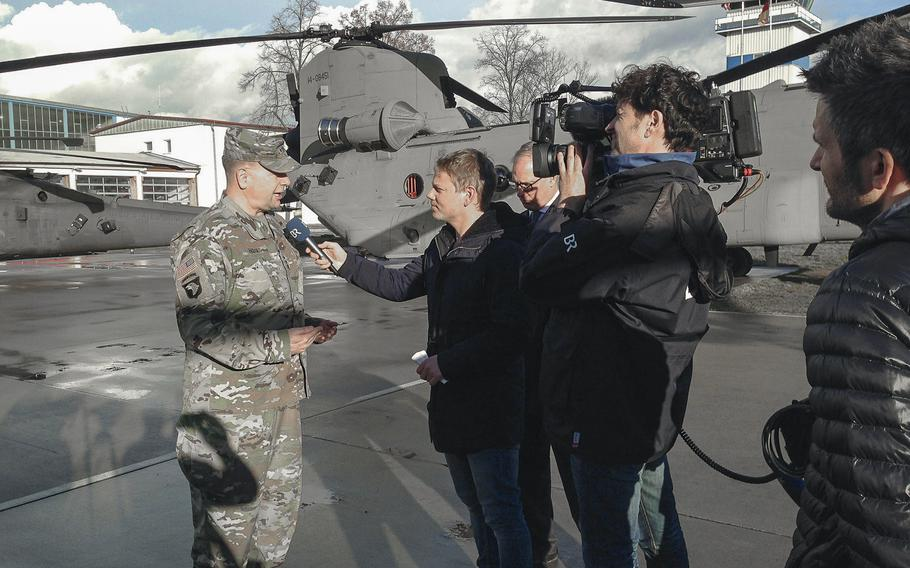 Lt. Gen. Ben Hodges, commander of U.S. Army Europe, speaks to a German reporters after a ceremony during which the10th Combat Aviation Brigade uncased its colors, symbolizing its arrival in Europe, at Storck Barracks in Illesheim, Germany, Thursday, March 9, 2017. The 10th CAB, of Fort Drum, N.Y., is the Army's first rotational aviation brigade in Europe.