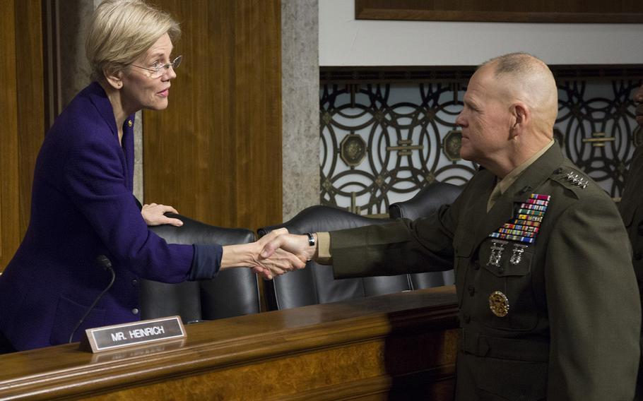 Marine Corps Commandant Gen. Robert B. Nellershakes hands with Sen. Elizabeth Warren, D-Mass., before a Senate Armed Services Committee hearing on the Marines United social media controversy, March 14, 2017 on Capitol Hill.