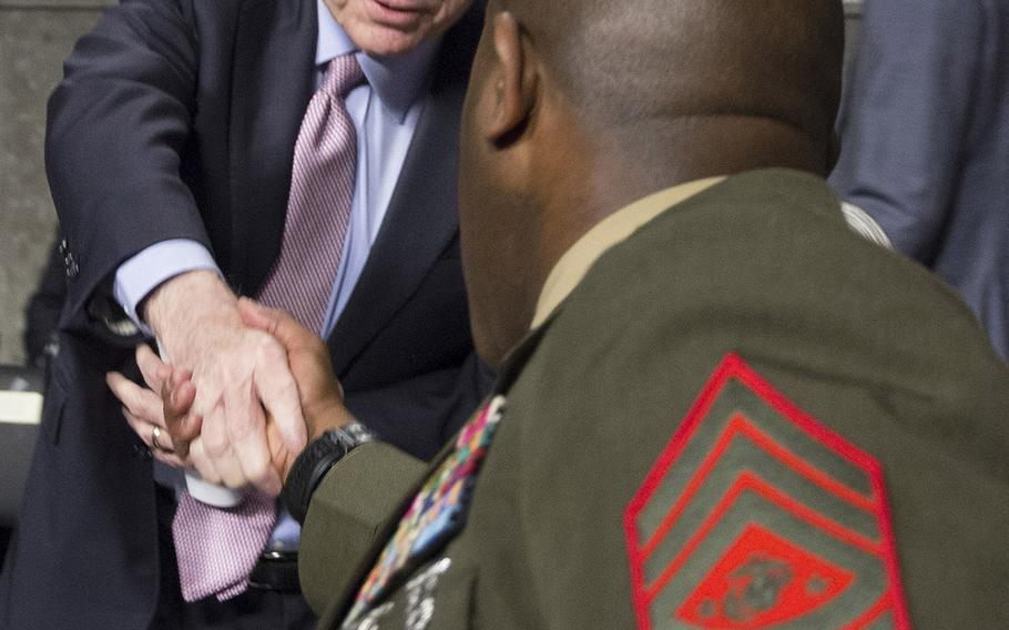 Senate Armed Services Committee Chairman John McCain, R-Ariz., shakes hands with Sergeant Major of the Marine Corps Ronald L. Green before a  hearing on the Marines United social media controversy, March 14, 2017 on Capitol Hill.