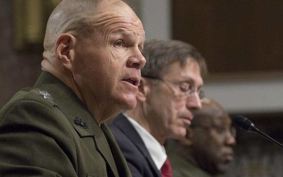 Marine Corps Commandant Gen. Robert B. Neller testifies during a Senate Armed Services Committee hearing on the Marines United social media controversy, March 14, 2017 on Capitol Hill. With him are Acting Secretary of the Navy Sean J. Stackley and Sergeant Major of the Marine Corps Ronald L. Green.