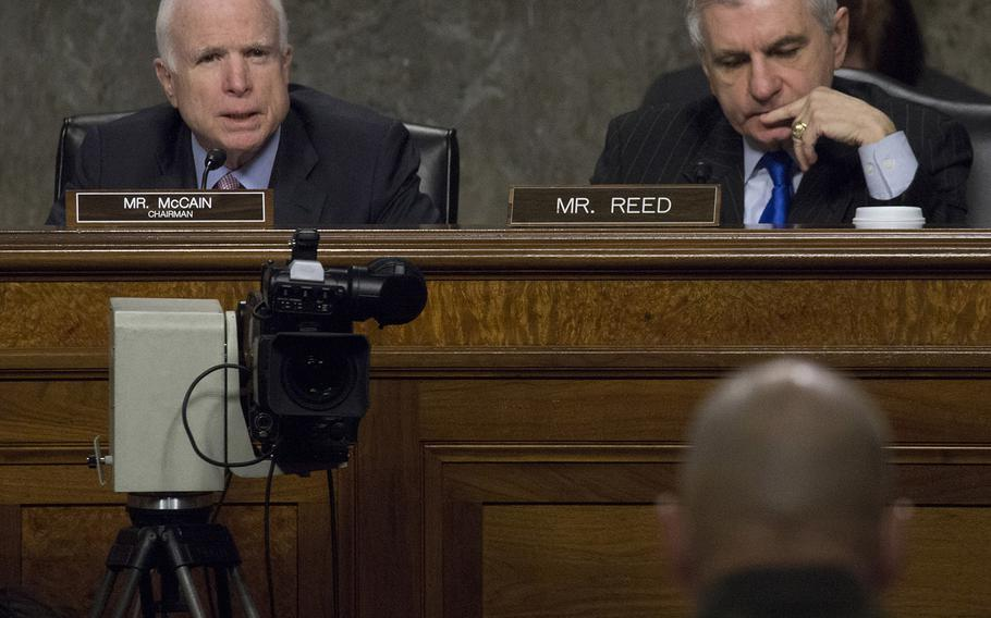 Senate Armed Services Committee Chairman John McCain, R-Ariz., questions Marine Corps Commandant Gen. Robert B. Neller, foreground, during a hearing on the Marines United social media controversy, March 14, 2017 on Capitol Hill. At right is Ranking Member Jack Reed, D-R.I.