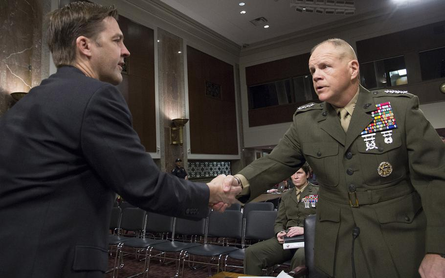 Marine Corps Commandant Gen. Robert B. Neller shakes hands with Sen.Ben Sasse, R-Neb., before a Senate Armed Services Committee hearing on the Marines United social media controversy, March 14, 2017 on Capitol Hill.