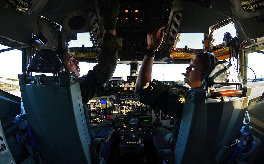 U.S. Air Force Capt. Scott Carlan, left, and Capt. Jack Ryan, 351st Expeditionary Air Refueling Squadron KC-135 Stratotanker pilots, prepare to depart Istres-Le Tube Air Base, France, Feb. 26, 2016.
