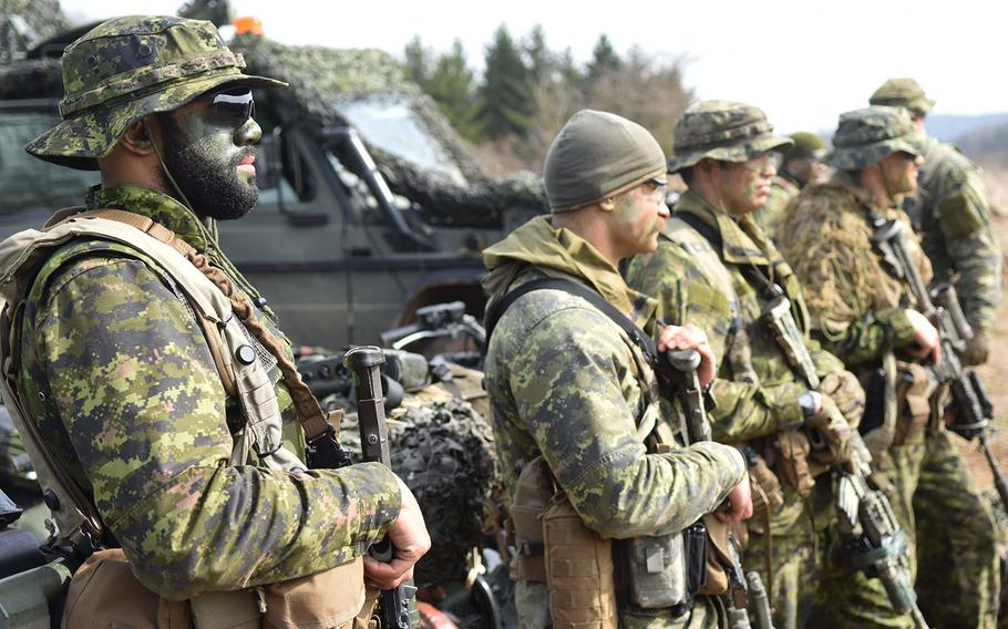 Canadian and U.S. soldiers displaying weapons and equipment during Exercise Allied Spirit, March 17, 2017.