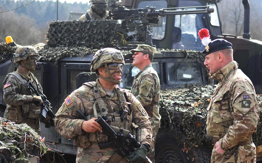 British and American soldiers discuss the day's training during Exercise Allied Spirit, March 17, 2017.