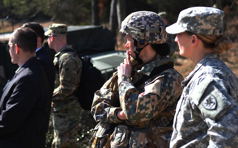 Latvian and American soldiers watch a demonstration during Exercise Allied Spirit, March 17, 2017.