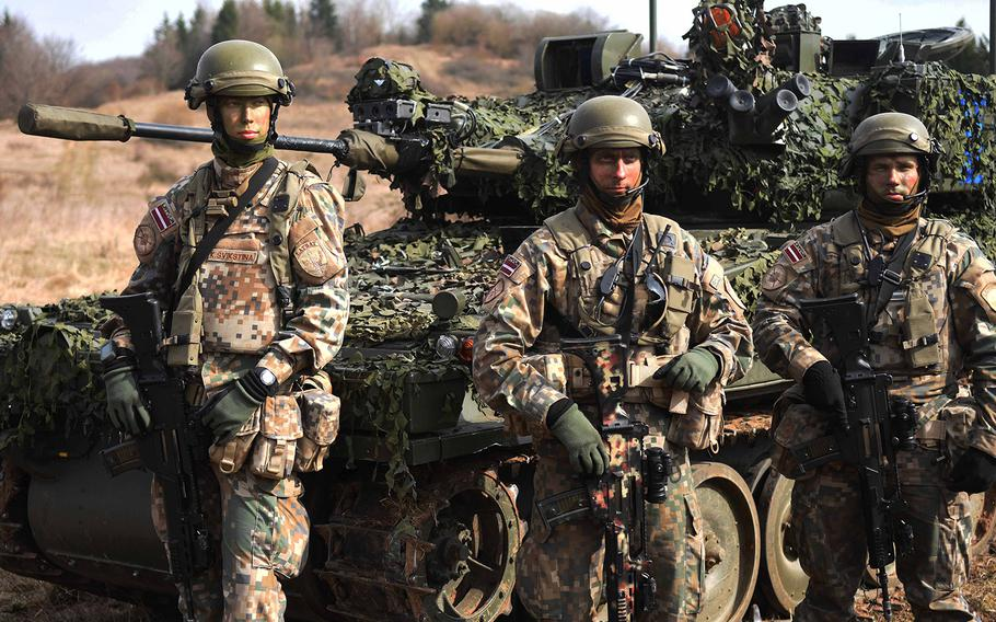 Latvian soldiers displaying equipment during Exercise Allied Spirit, March 17, 2017.
