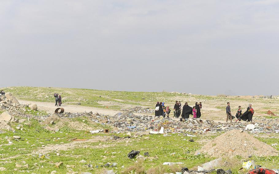 Iraqis stream out of western Mosul districts on Wednesday, March 8, 2017.