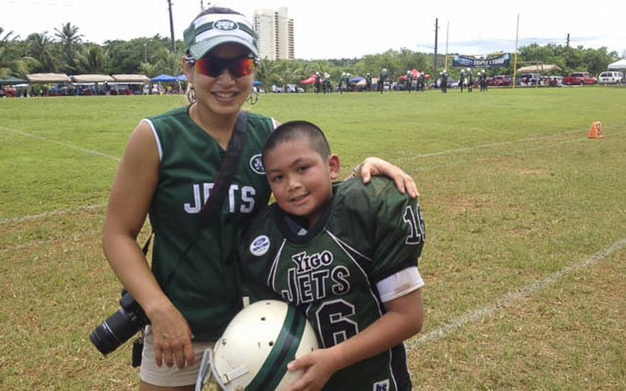 Gail Martinez and her son Kimo after a football game in Guam in 2012.