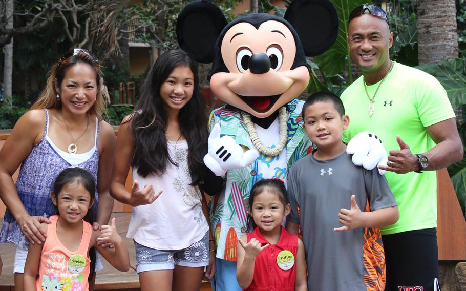 The Martinez family at the Aulani Disney Resort in Hawaii in 2012.