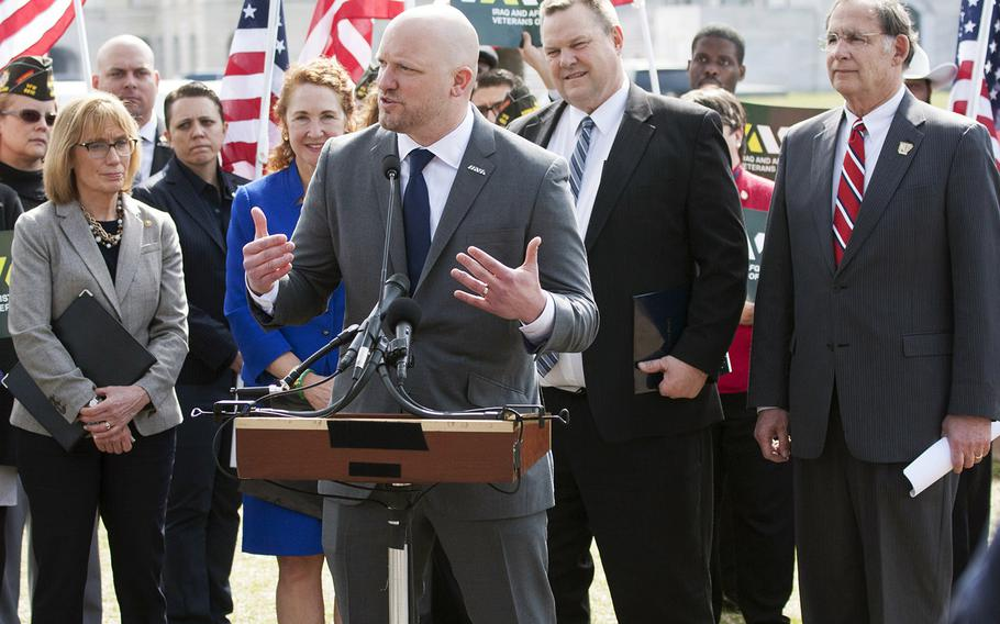 Iraq And Afghanistan Veterans Of America IAVA founder and CEO Paul Rieckhoff speaks at a Capitol Hill press conference on March 21, 2017. Behind him are, left to right, Sen. Maggie Hassan, D-N.H., Rep. Elizabeth Esty, D-Conn., Sen. Jon Tester, D-Mont., and Sen. John Boozman, R-Ark.