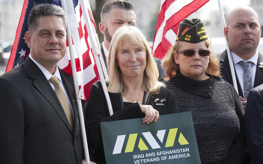 Veterans listen to one of the speakers at a Capitol Hill press conference on March 21, 2017.