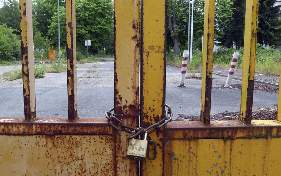 A locked gate bars entry to a former U.S. base in Darmstadt, Germany.