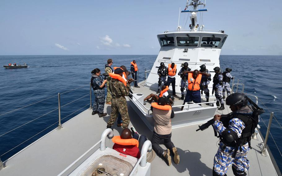 The Ivorian Maritime Interdiction Operations team conduct a simulated anti-narcotics search-and-seizure raid on March 27, 2017, near Cote d'Ivoire during the Obangame Express exercise.