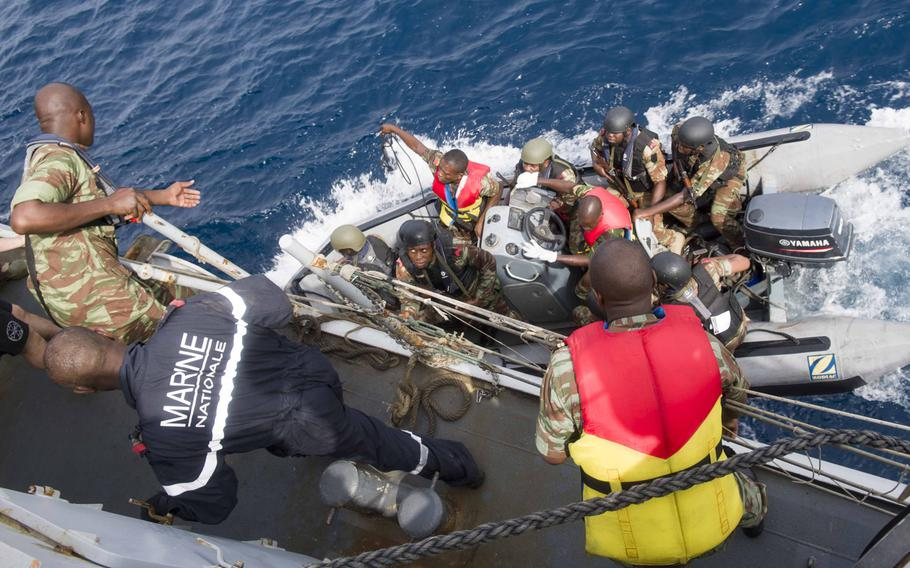 Benin sailors board the French frigate E.V. Jacoubet March 26, 2017, as part of a search-and-seizure drill in Cotonou, Benin, during the 12-day Obangame Express exercise.