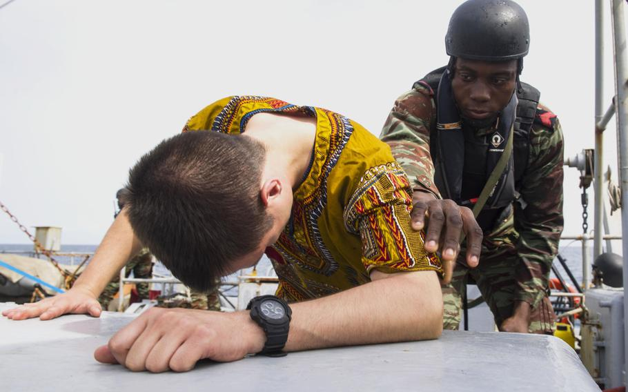 Benin sailor Gamavo Weely searches a French sailor in a practice raid on the French frigate E.V. Jacoubet March 26, 2017 during Obangame Express, a 12-day exercise that U.S. Africa Command hosted to improve West African nations' policing of their waters.