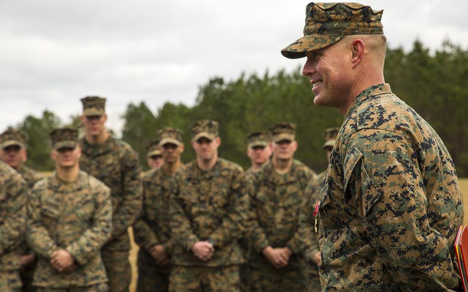 """U.S. Marine Staff Sgt. Nathan A. Hervey speaks at Marine Corps Base Camp Lejeune, N.C., Feb. 5, 2016. Hervey was awarded the Bronze Star Medal with the combat distinguishing device for valor. New regulations will see the authorization of """"C"""" and """"R"""" devices to be added to some awards."""