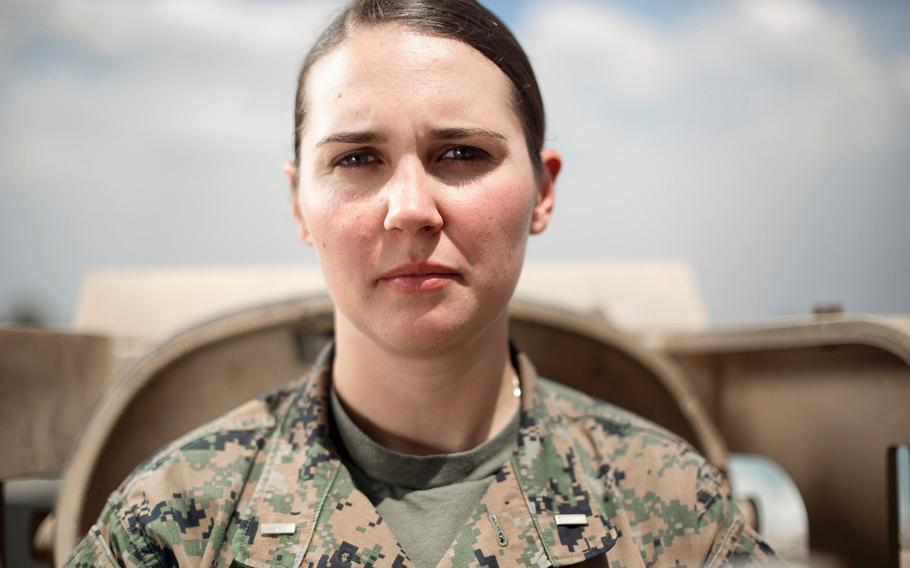 Standing in front of an M1A1 Abrams tank, 2nd Lt. Lillian Polatchek is the first female Marine Tank Officer after graduating as the distinguished honor graduate of her Army's Armor Basic Officer Leaders Course on April 12, 2017.