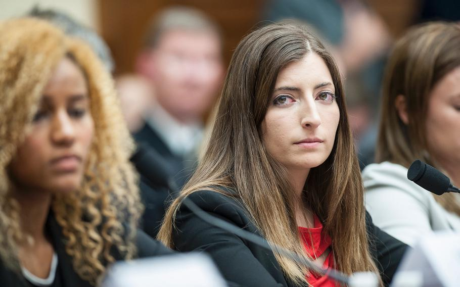 Former Army cadet Stephanie Gross looks on as another witness testifies on Tuesday, May, 2, 2017, during a House Armed Services subcommittee hearing in which members heard testimony from sexual assault victims as part of an overview of an annual report on sexual harassment and violence at the military service academies. At left is former Army cadet Ariana Bullard and at right former Navy midshipman Annie Kendzior. Not seen is Navy Midshipman 2nd Class Sheila Craine.