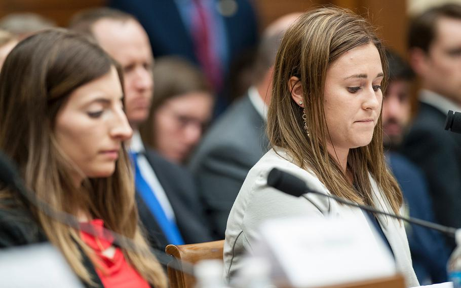 Former Navy midshipman Annie Kendzior, right, looks down while testifying on Tuesday, May, 2, 2017, during a House Armed Services subcommittee hearing in which members heard testimony from sexual assault victims as part of an overview of an annual report on sexual harassment and violence at the military service academies. At left is former Army cadet Stephanie Gross who also testified.