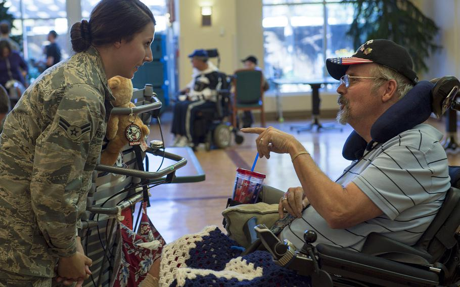 In a December, 2016 file photo, U.S. Air Force Airman 1st Class Maygan Straight speaks with retired Air Force Chief Master Sgt. Ron Evans during a visit to the Veterans Victory House in Walterboro, S.C.