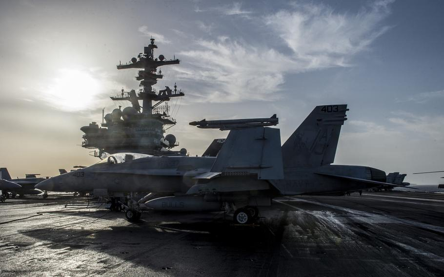 An F/A-18 Super Hornet sits on the flight deck of the aircraft carrier USS George H.W. Bush April 20, 2017. The Bush is currently deployed to the Persian Gulf supporting maritime security operations and the coalition to defeat the Islamic State in Iraq and Syria.