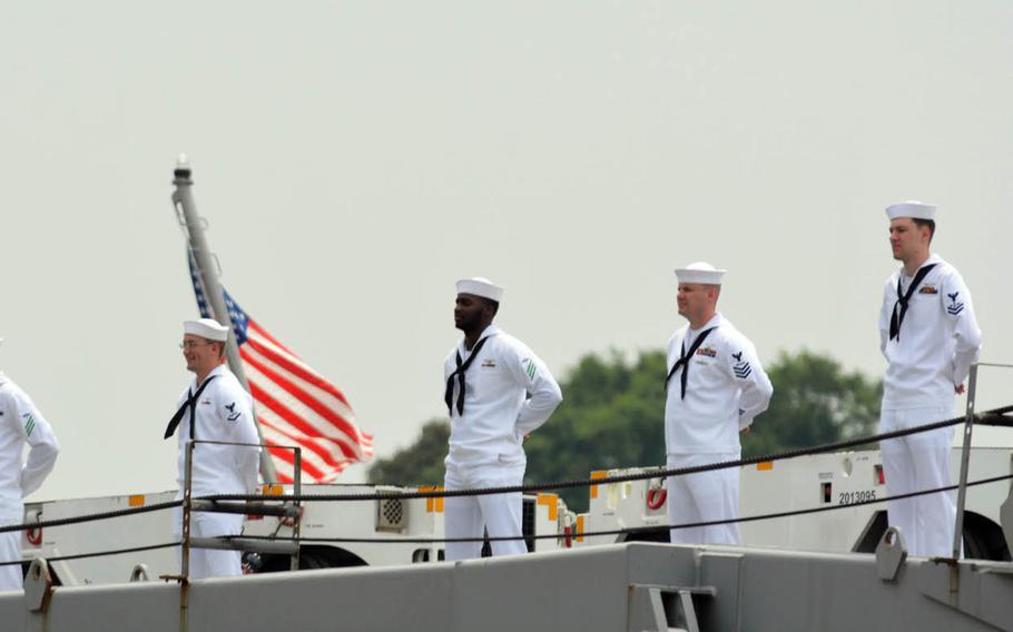 Sailors man the rails as the aircraft carrier USS Ronald Reagan prepares to depart Yokosuka Naval Base, Japan, Tuesday, May 16, 2017.