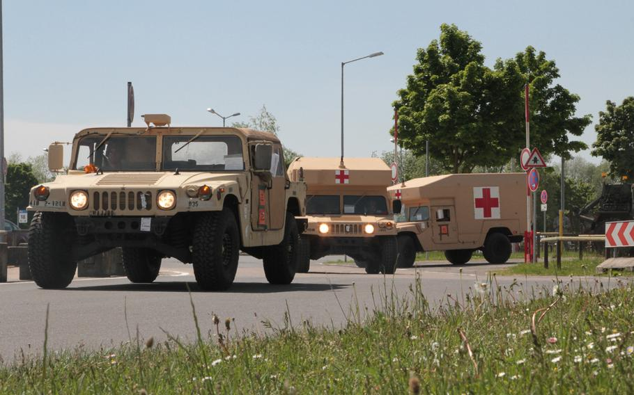 A High Mobility Multipurpose Wheeled Vehicle (HMMWV) and two military ambulances from the 2nd Battalion, 12th Infantry Regiment depart in a convoy from Nuremberg Airport, Germany on May 16, 2017. The light infantry unit recently completed an Emergency Deployment Readiness Exercise to Germany and is moving to Grafenwoehr Training Area for follow-on exercises over the next month.