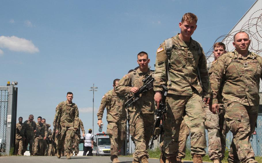 Soldiers from the 2nd Battalion, 12th Infantry Regiment, 2nd Infantry Brigade Combat Team, 4th Infantry Division, depart for training after a flight to Nuremberg Airport, Germany on May 16th, 2017. The battalion, which flew to Germany on short notice as part of an Emergency Deployment Readiness Exercise, will be using equipment from Army Prepositioned Stock sites during follow-on training in Bavaria.