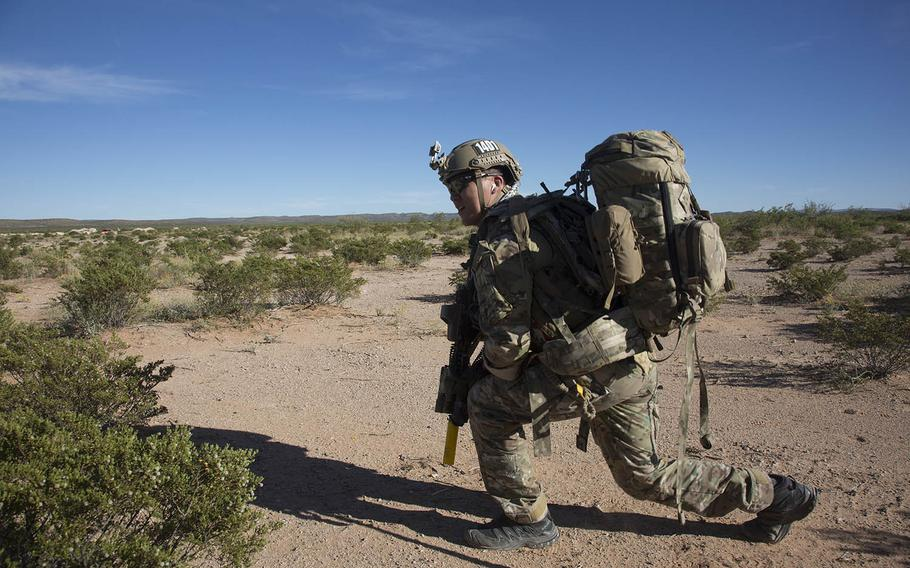 Special Forces soldiers conduct a downed pilot simulationat Fort Bliss in Texas on Oct. 18, 2016. The Army and Marine Corps have worked together to determine how they can reduce the weight of gear used by combat troops through better materials, manufacturing and doctrine.