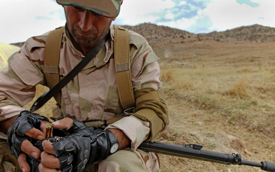 A Peshmerga soldier loads ammunition into his magazine in preparation for squad-based training near Erbil, Iraq, on Oct. 14, 2015. According to military officials, Combined Joint Task Force-Operation Inherent Resolve coalition partners had planned in 2015 to provide millions of rounds of ammunition, as well as small arms, machine guns, mortars, radios, vehicles, and other equipment over the next several months to Iraqi Security Forces. Some of this equipment has been purchased using the Iraq Train and Equip Fund.