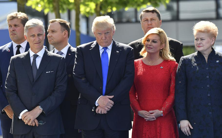 Belgian King Philippe, from left, U.S. President Donald Trump, Croatian President Kalinda Grabar-Kitarovic and Lithuanian President Dalia Grybauskaite attend a ceremony at NATO headquarters in Brussels on Thursday, May 25, 2017.