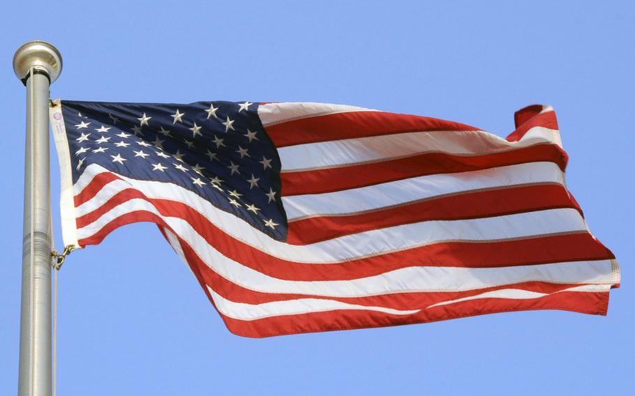 An American flag blows in the breeze.
