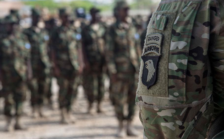Five U.S. Army 101st Airborne soldiers deployed with U.S. Army Africa to train Somali National Army soldiers stand at a graduation formation on May 23, 2017, in Mogadishu, Somalia.