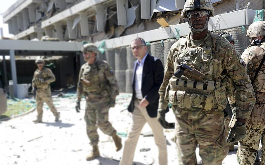 Military personnel are seen at the site of the May 31, 2017, suicide bombing that killed scores of people and wounded hundreds more. On Friday, June 2, Afghan police fired warning shots and fought a running battle with angry anti-government protesters.