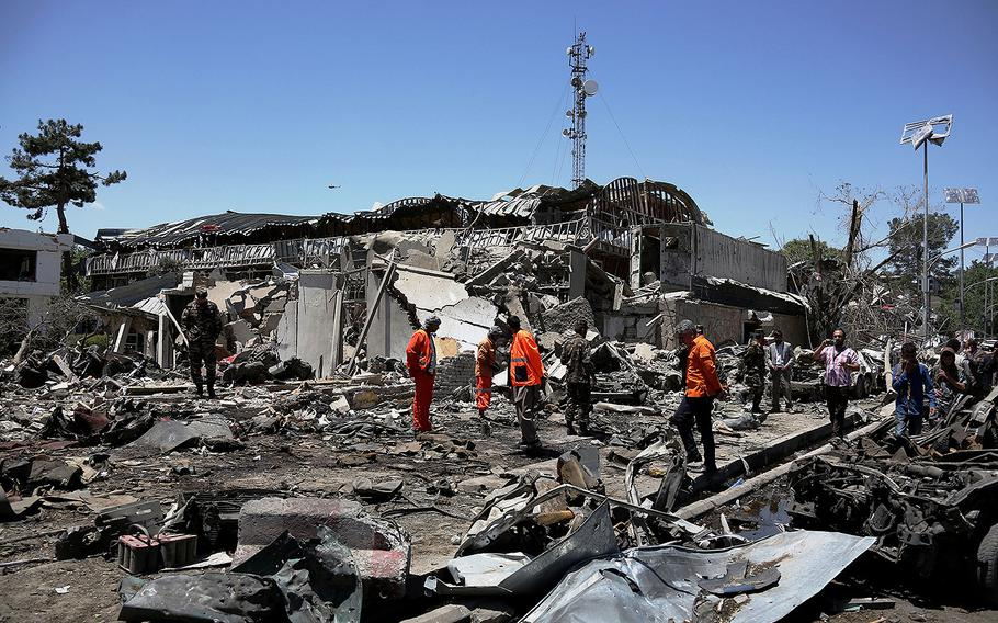 Rescue workers comb through the site of a car bomb explosion on May 31, 2017 in Kabul, Afghanistan.