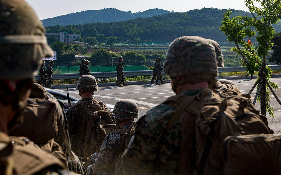 U.S. Marines and sailors with India Company, 3rd battalion, 8th Marines, forward deployed to the 3rd Marine Division, as part of the forward Unit Deployment Program, observe Republic of Korea Marines hiking on Camp Mujuk, South Korea on May 29, 2017.