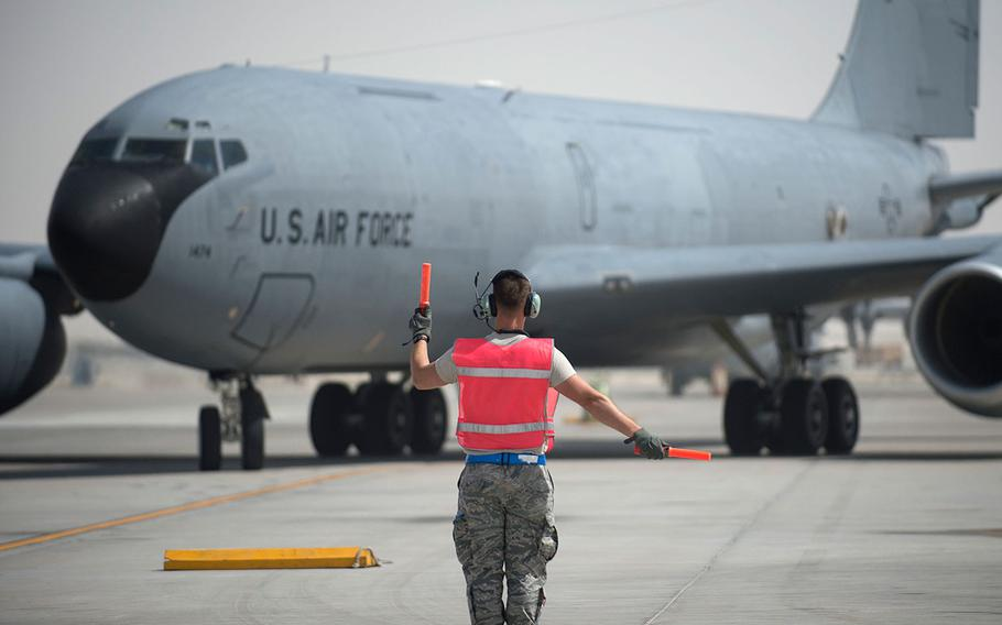 A U.S. Air Force airman with the 379th Expeditionary Aircraft Maintenance Squadron marshals a KC-135 Stratotanker at Al Udeid Air Base, Qatar on May 29, 2017.