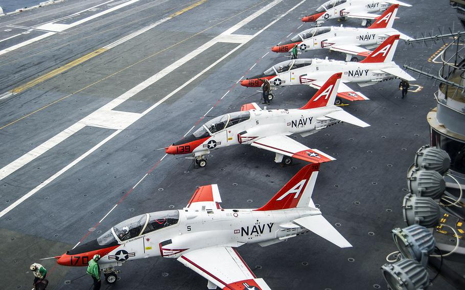 Pilots perform pre-flight procedures in T-45C Goshawks from Training Air Wing One 1 on the flight deck of the aircraft carrier USS George Washington in December, 2016.