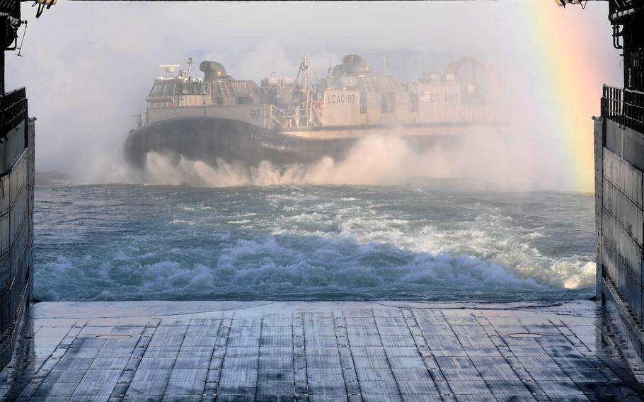 A landing craft departs the well deck of the USS Arlington during a simulated beach invasion in Ventspils, Latvia, on June 6, 2017 as part of BALTOPS, a multinational maritime exercise in the Baltic Sea region. Fourteen countries participated this year.