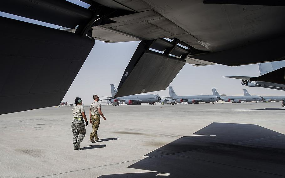 A KC-135 Stratotanker pilot, assigned to the 340th Expeditionary Air Refueling Squadron, walks with a maintainer, assigned to the 340th Aircraft Maintenance Unit, before a mission at Al-Udeid Air Base, Qatar, May 31, 2017.